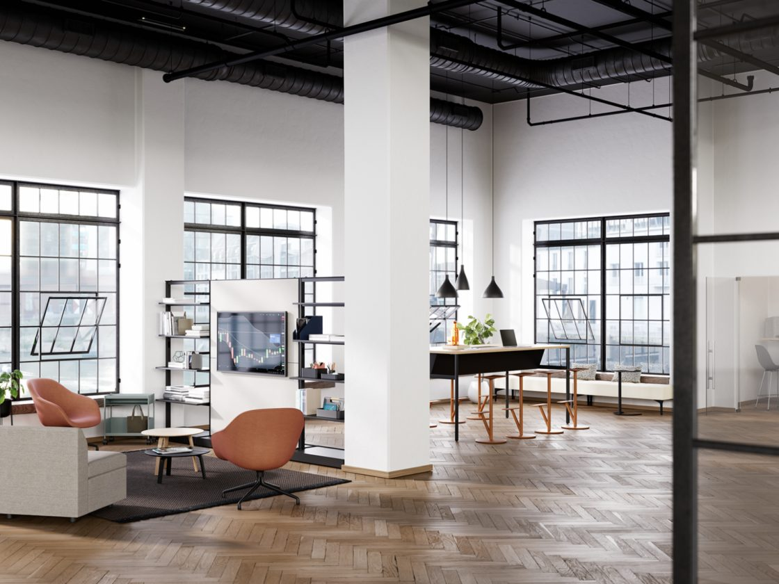 A lounge area featuring the OE1 Storage Trolley, OE1 Agile Wall, OE1 Communal Table, and the OE1 Micro Pack.