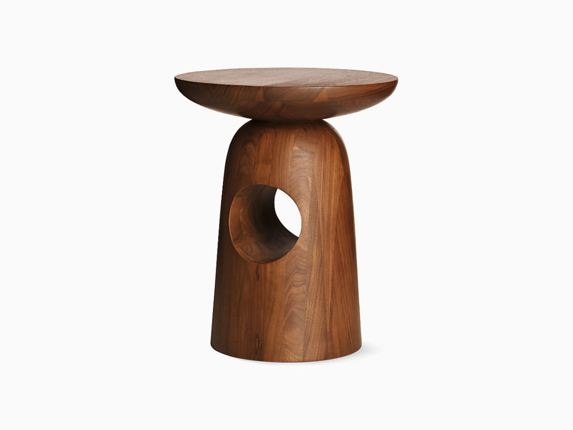 An image of Hew Shape E which is a solid wood figure with a shallow bowl shaped top on top of a rounded cone shape with a hole in its middle.