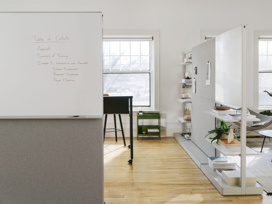 Multiple Agile Walls with different configurations enclosing a work space and providing privacy.