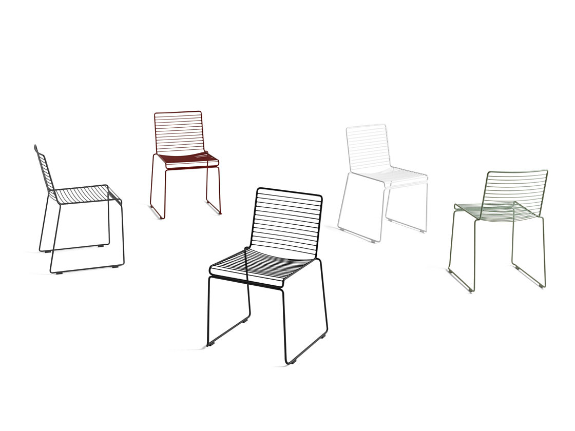 A collection of HAY Hee Dining Chairs in different colors - black, white, green, red, and navy - on a white background.