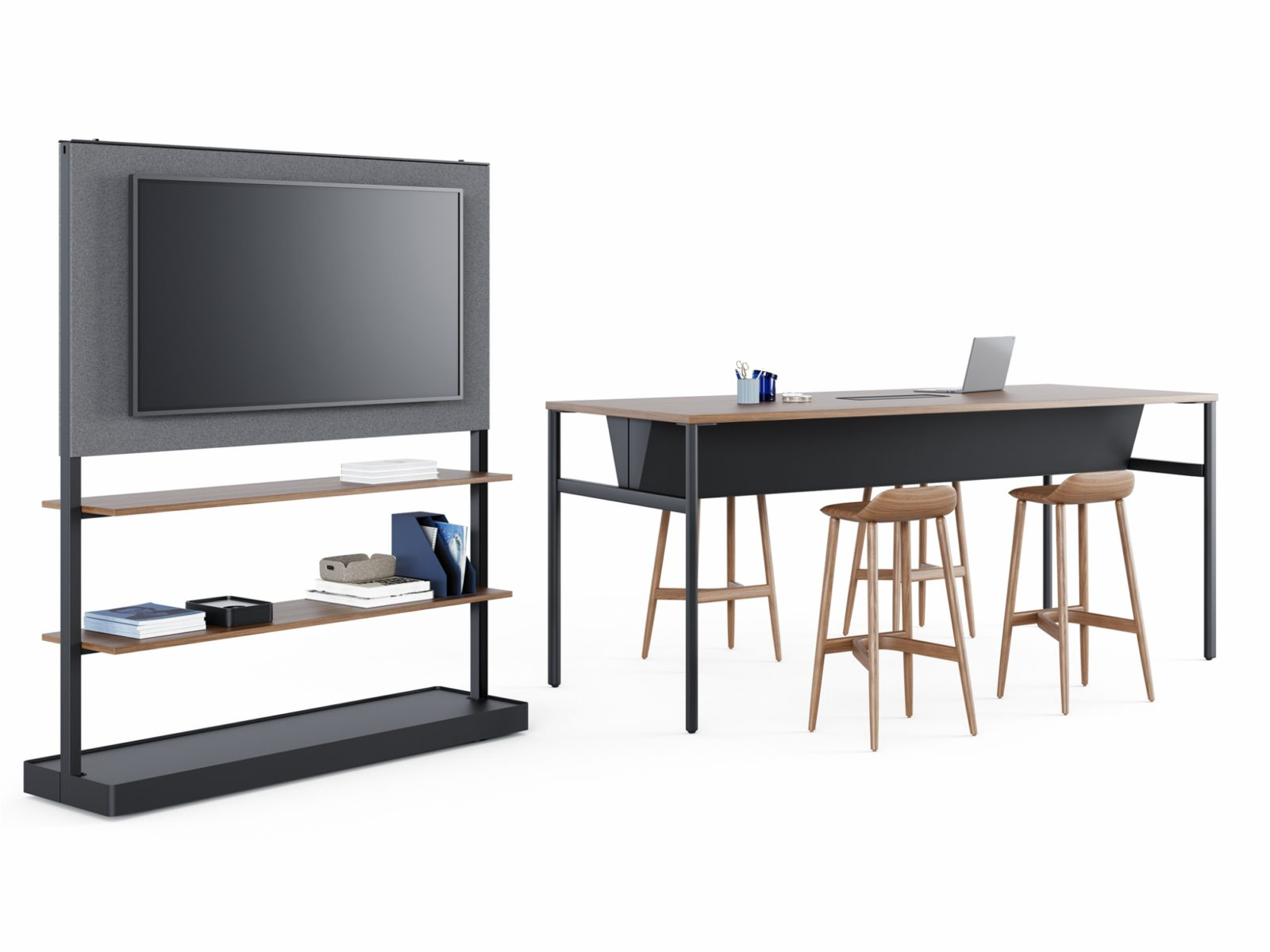 An Agile Wall with a monitor mounted on a dark grey fabric tile with two storage shelves holding office supplies below it next to a navy Communal Table.