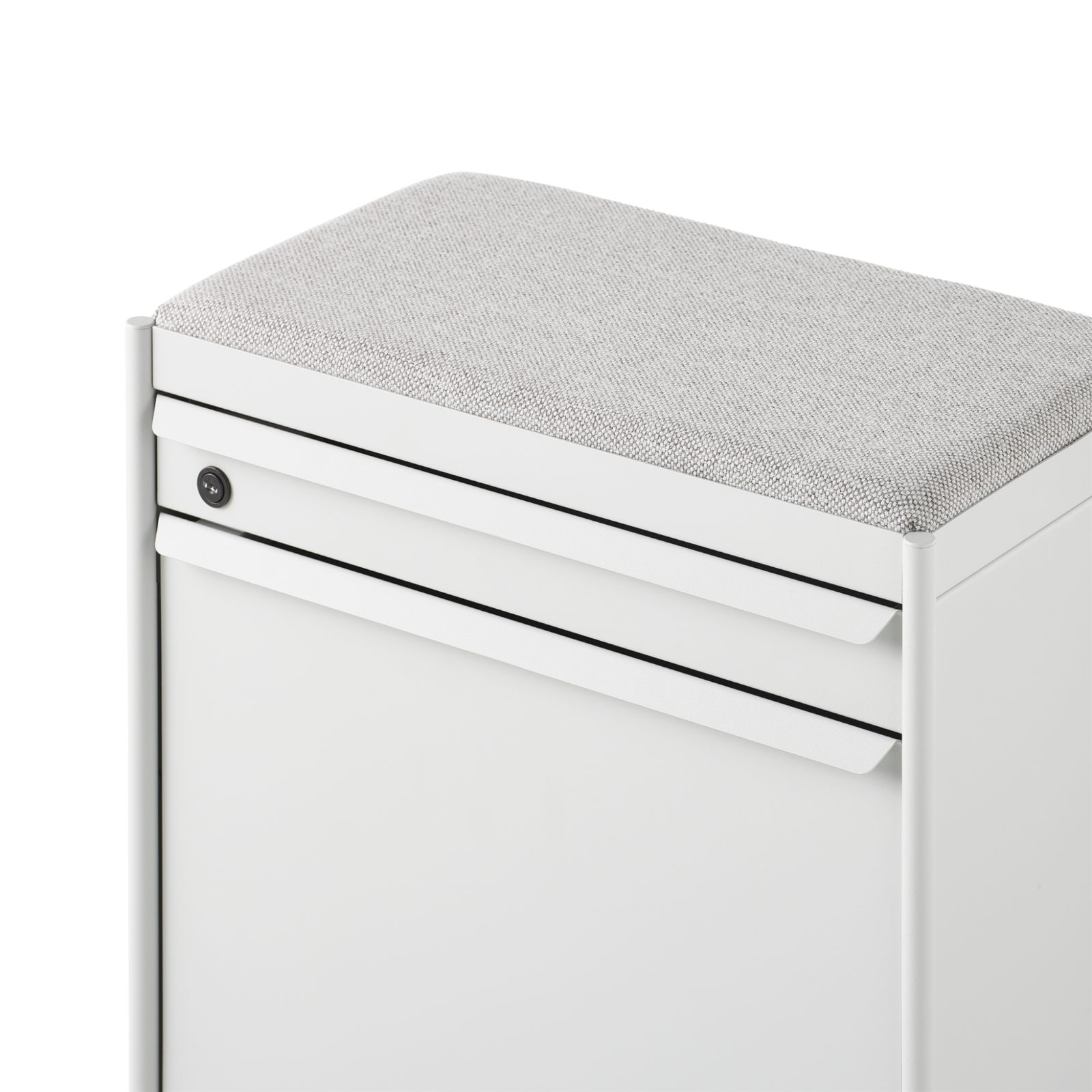 A grey fabric cushion top on a white OE1 Storage Trolley with a lockable top drawer and bottom tip-out bin.