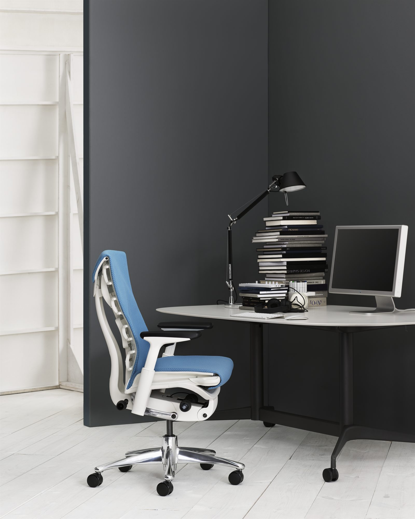 An image of a home office with a blue Embody chair.