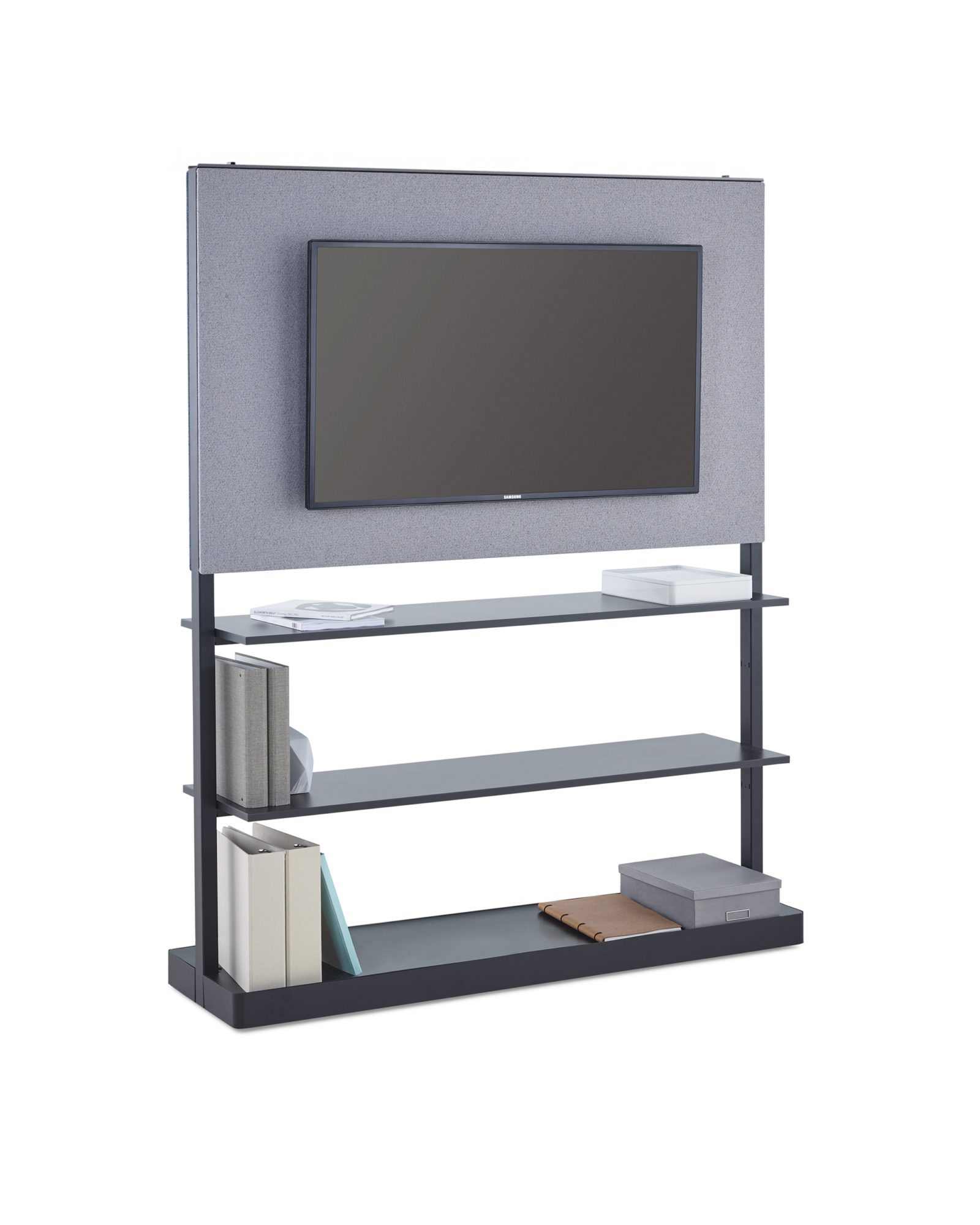 An Agile Wall with a monitor mounted on a grey fabric tile with 3 shelves storing office equipment below.