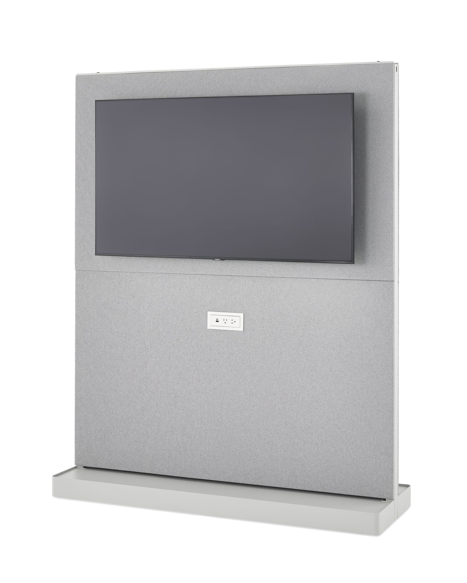 An Agile Wall with a grey tackable fabric tile, a mounted monitor, and integrated power receptacle.