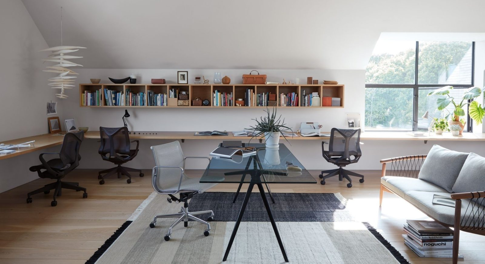 An image of a home office with Cosm chairs and a Geiger Crosshatch Sofa.