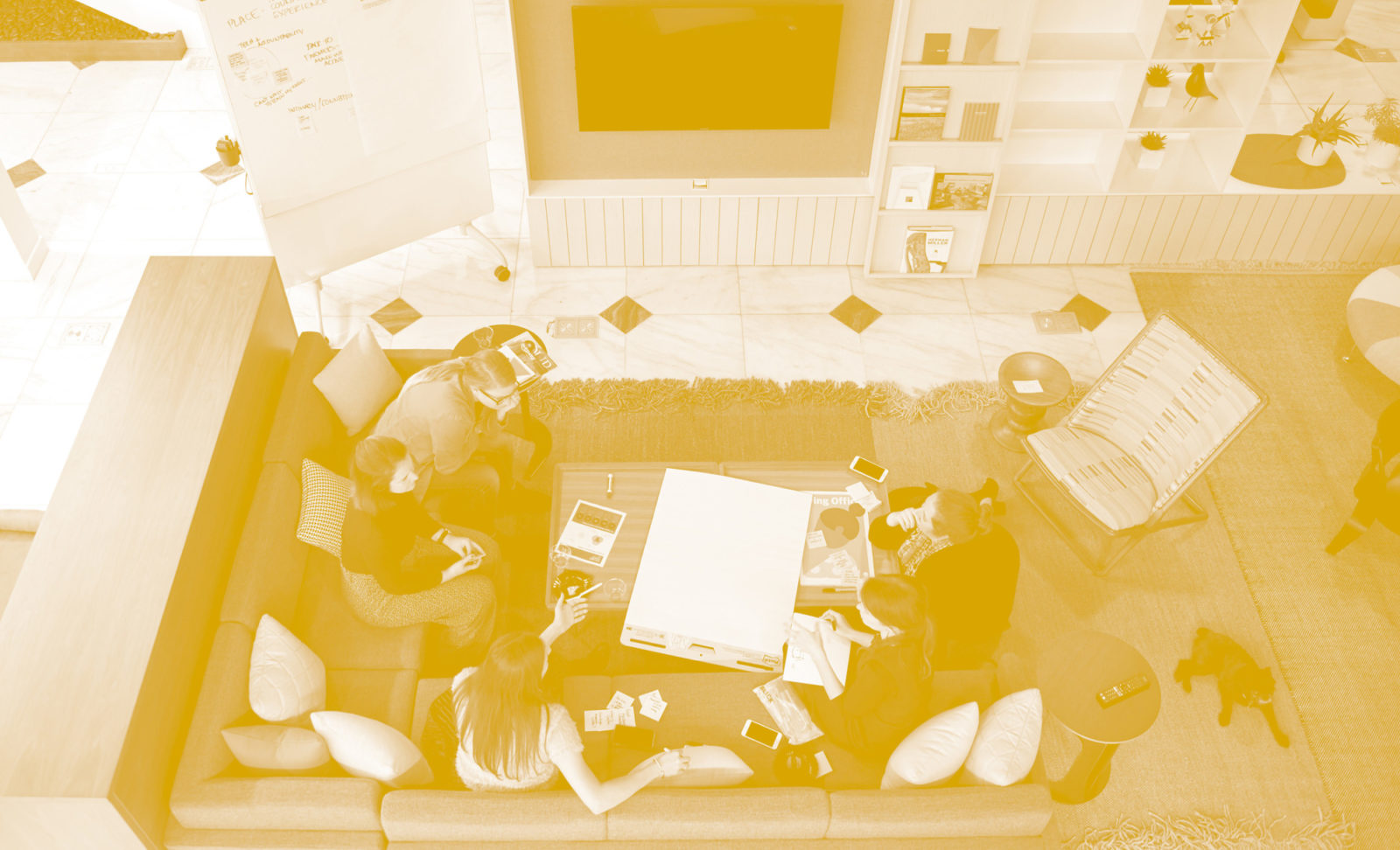 An overhead view of a group of designers sitting on the l-shaped couch on the main floor of the MarxModa headquarters in downtown Detroit, MI.