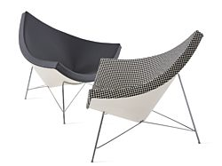 Two Nelson Coconut Lounge Chairs, one black leather and one black and white checkered, facing each other on a white background.
