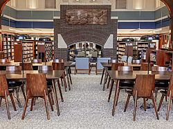 The interior of the Ewald Branch with rows of long wooden tables surrounded by wooden Agati chairs.