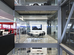 A conference room made from Maars glass walls and steel frames.