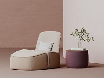 An image of Hightower soft seating including a peach upholstered lounge chair and ottoman next to a pink ottoman.