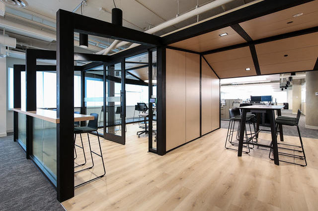 The interior of an office with wood, metal, and glass interior partitions.