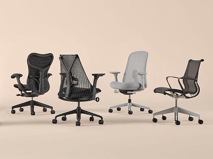 A black Mirra 2, black Sayl, grey Lino, and black Setu task chair arranged on a peach background.