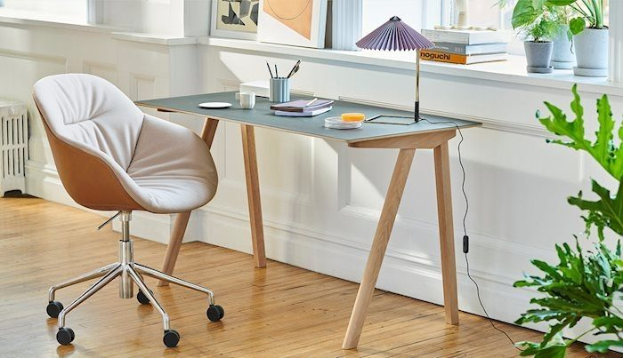 An image of a home office with a chair, desk, and lamp from HAY.