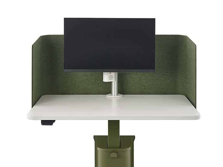A green OE1 Micro Pack with a monitor mounted on a white monitor arm with a green privacy screen mounted along the back of the work surface.