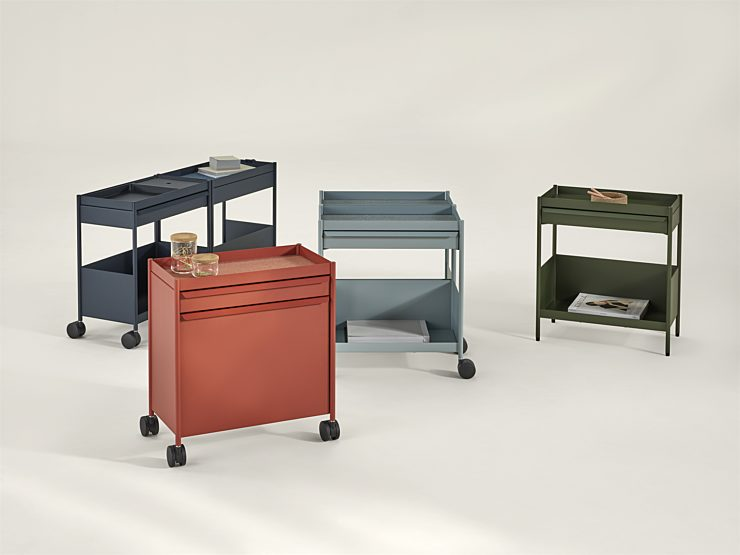 A navy, red, light blue, and green OE1 Storage Trolley, each with a different configuration, arranged together on a white background.