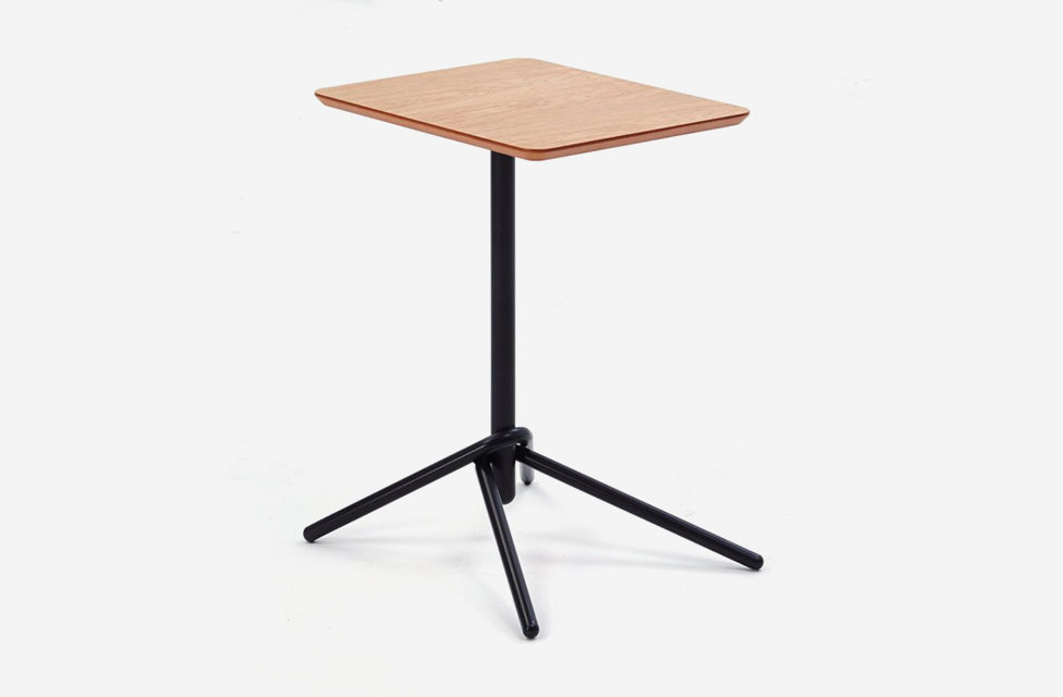 An image of a Knot Table with a black knotted base and a round wood top on a white background.
