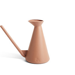 A terracotta colored HAY Watering Can on a white background.