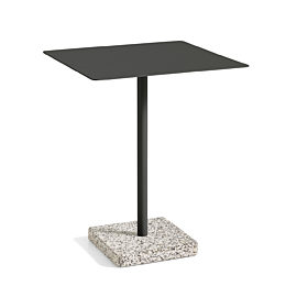A HAY Terrazzo Table with a black square top and a grey terrazzo base on a white background.